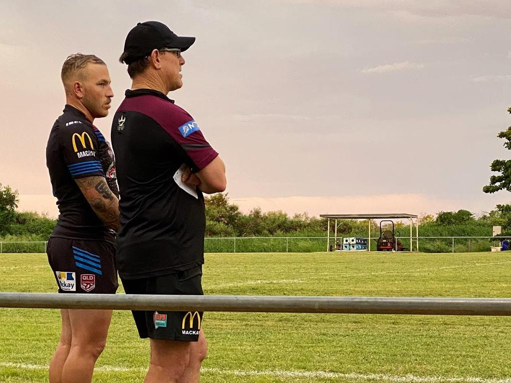 Mackay Cutters player Tyler Gardiner (left) watches on from the sideline during Saturday's trial against the Townsville Blackhawks in Bowen.