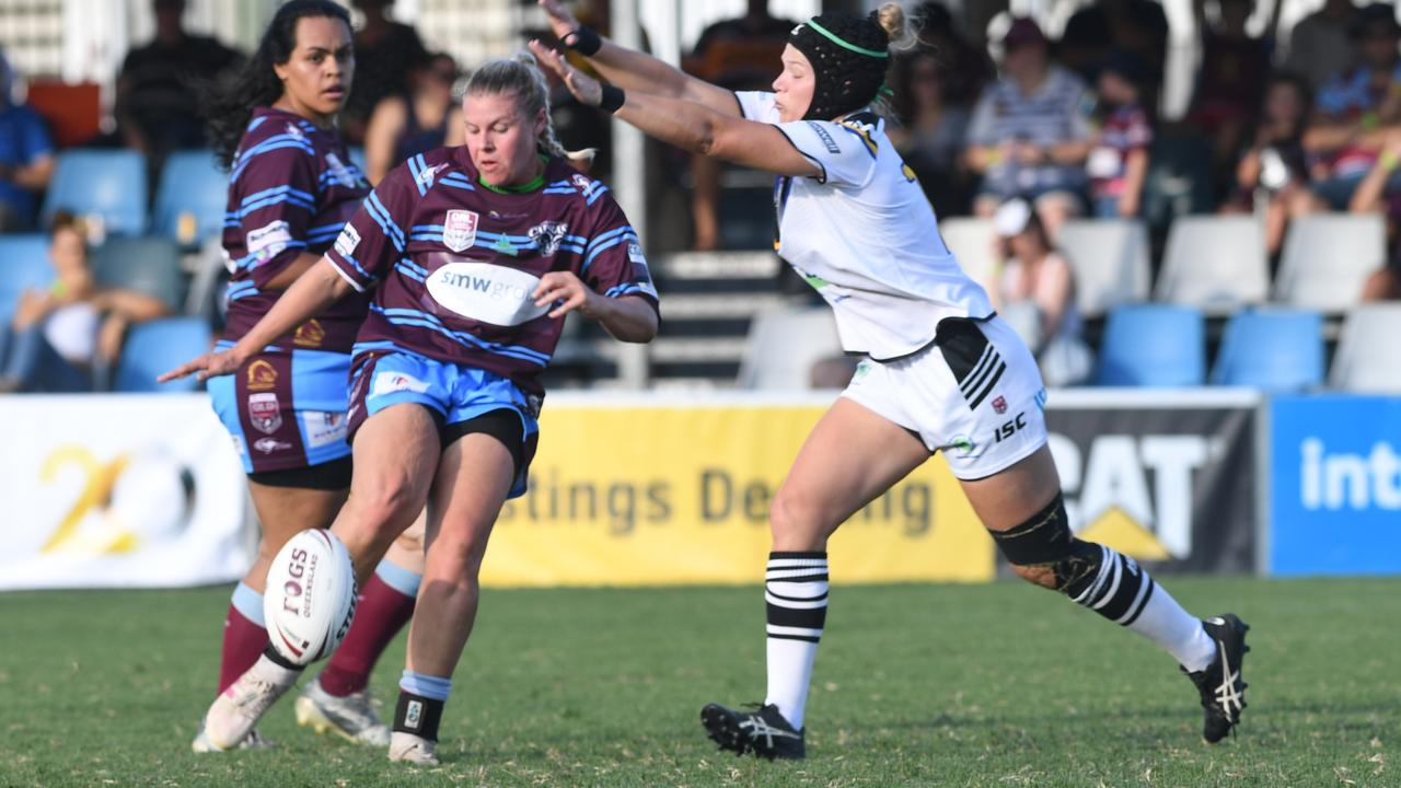 IMPRESSIVE EFFORT: CQ Capras player Kailah Rogers gets a kick away as the Souths Logan Magpies defence closes in during the trial game at Browne Park on Saturday Picture: Jann Houley