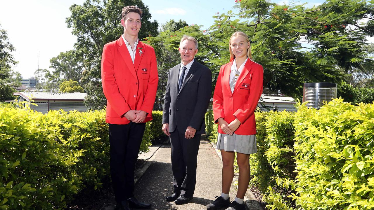 Benowa State High School has topped the state with their OP results. Principal Mark Rickard with school captains Matthew Coombes and Jemma Davey. Photo: AAP/Richard Gosling