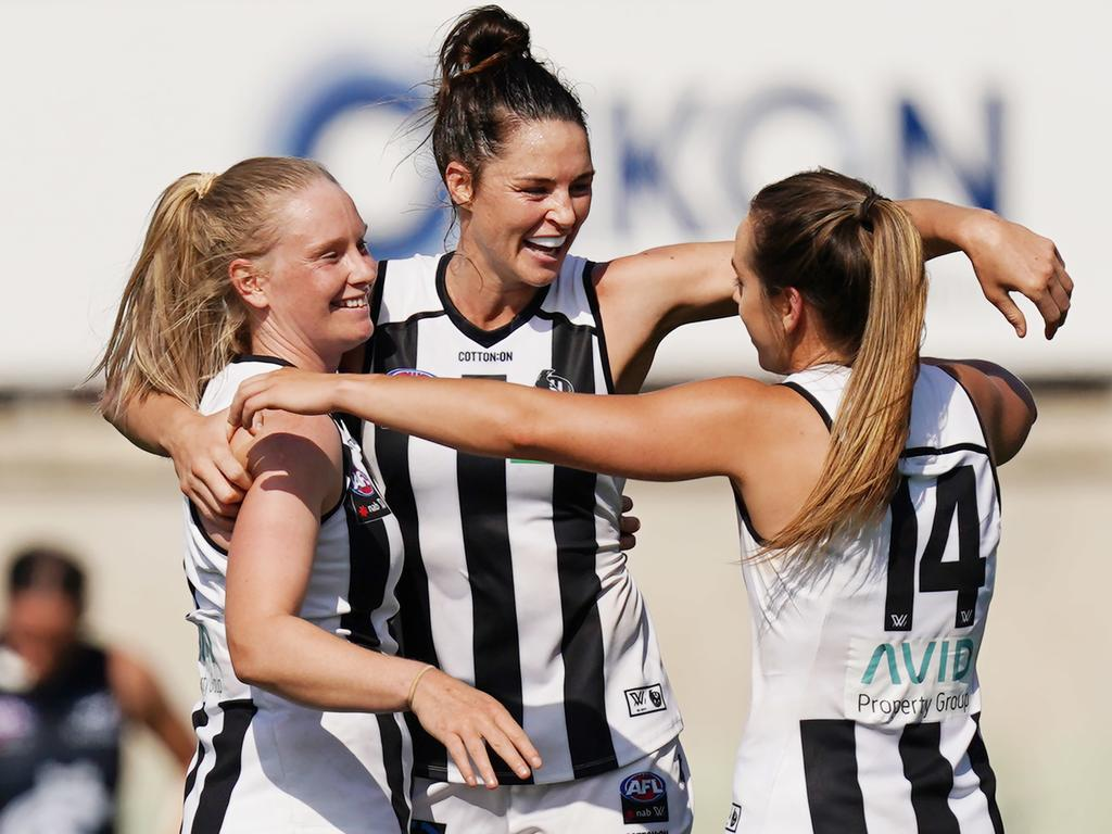 The Magpies celebrate their first ever win over Carlton in the AFLW
