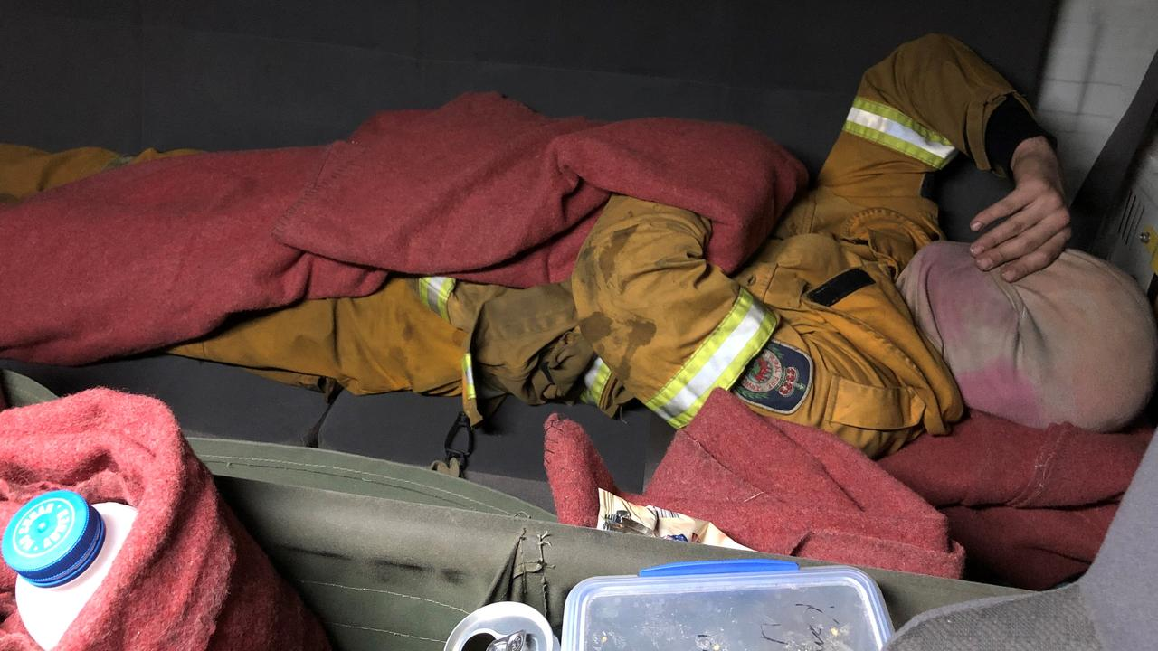 Southampton RFS crew member Shep trying to get a quick rest after 15 hours at Nymboida fire on the night of November 8th, 2019.