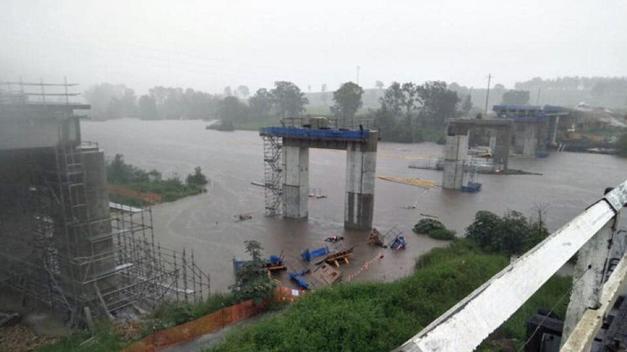 VIEW FROM THE TIMBER BRIDGE: Tabulam Bridge is nearing completion despite heavy rainfall. PHOTO: TABULAM SES