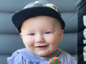 Baby in coma as community rallies for grieving family