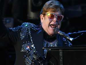 Elton John leaves stage in tears
