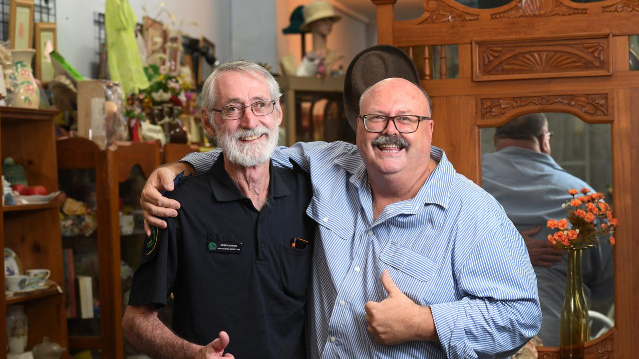 Pine Mountain District Rural Fire Brigade first officer Denis Mahon accepts a $3300 cheque from Glen Smith from ArtsConnect Ipswich Inc. The money was raised with a cent auction.