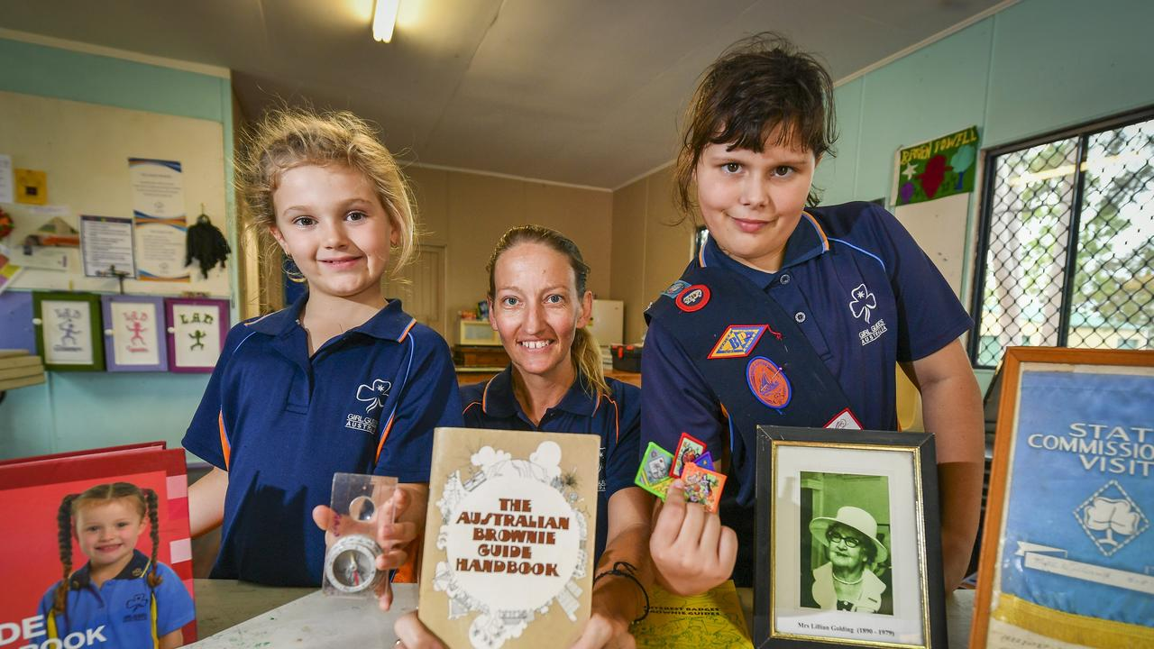 Gladstone girl Guides Poppi Ahern (LEFT) and Tamsin Roberts (RIGHT) with co-unit leader Donna Ellis as the QueenslandGirl Guides celebrate their centenary last year.