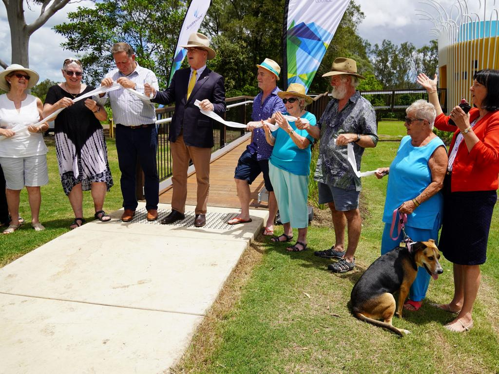 Councillor Greg Rogerson and Mayor Mark Jamieson cutting the toilet paper to open the designer dunny at Kenilworth.