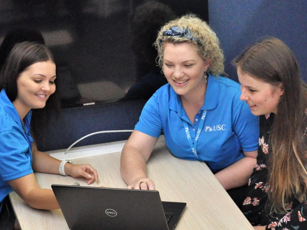 USC B Block Gympie campus 2020 - the biggest intake ever will undergo orientation day this week. USC Gympie students Kristen Schlein, Hayley Brennan and Taylor Mosk try out the new learning space, which is designed for quiet individual study and group work.