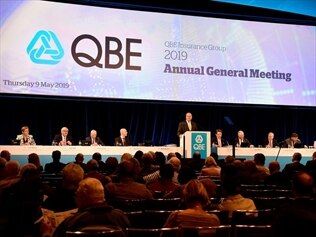 QBE management and shareholders at a general meeting