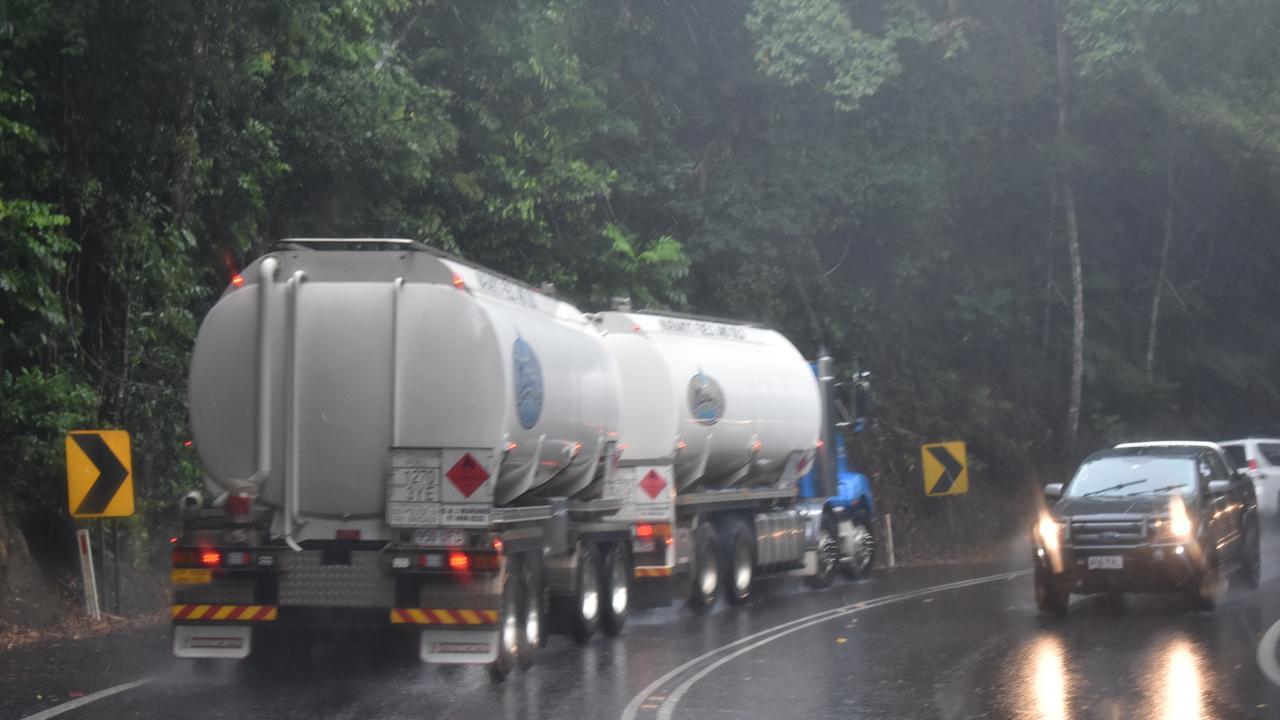 It was raining heavily as John Myles carefully drove his Kenworth down the notorious Kuranda Range.