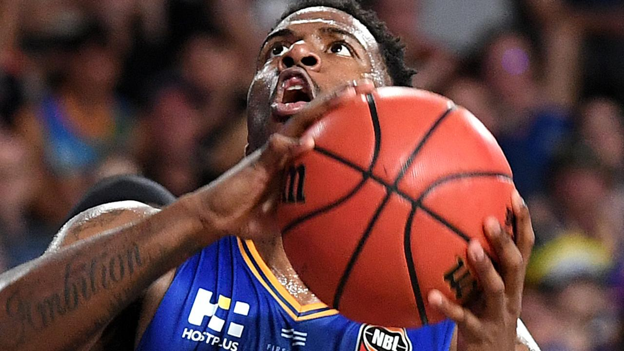 Lamar Patterson on his way to the basket against the Cairns Taipans. Picture: AAP Image/Dan Peled