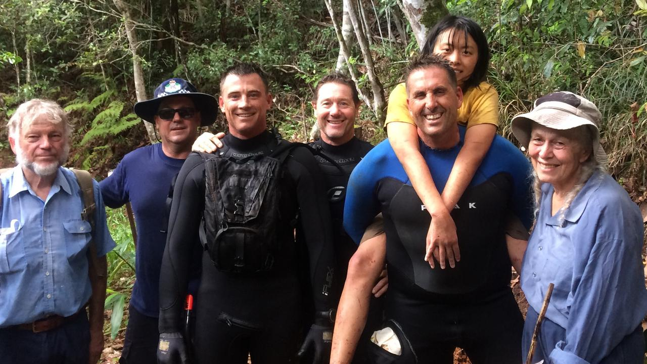 The Gold Coast search and rescue team with missing Chinese tourist Yang Chen who had been missing for five days near Gorge Falls Tallebudgera. Picture: QPS.