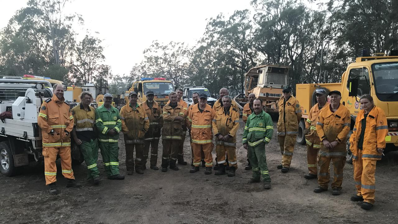 A TEAM: Rural firefighters who successfully worked on containment lines to control the bushfire at Black Snake on Wednesday night.