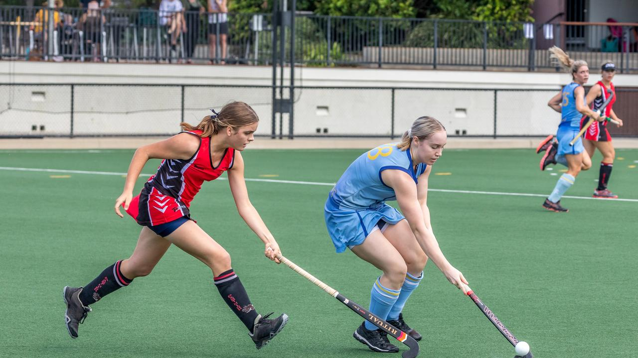 Ella Rogers of Past High pressures Imogen Turner of St Andrews during the 2020 Tiger Turf Cup. Photo: Andrew Blanchard