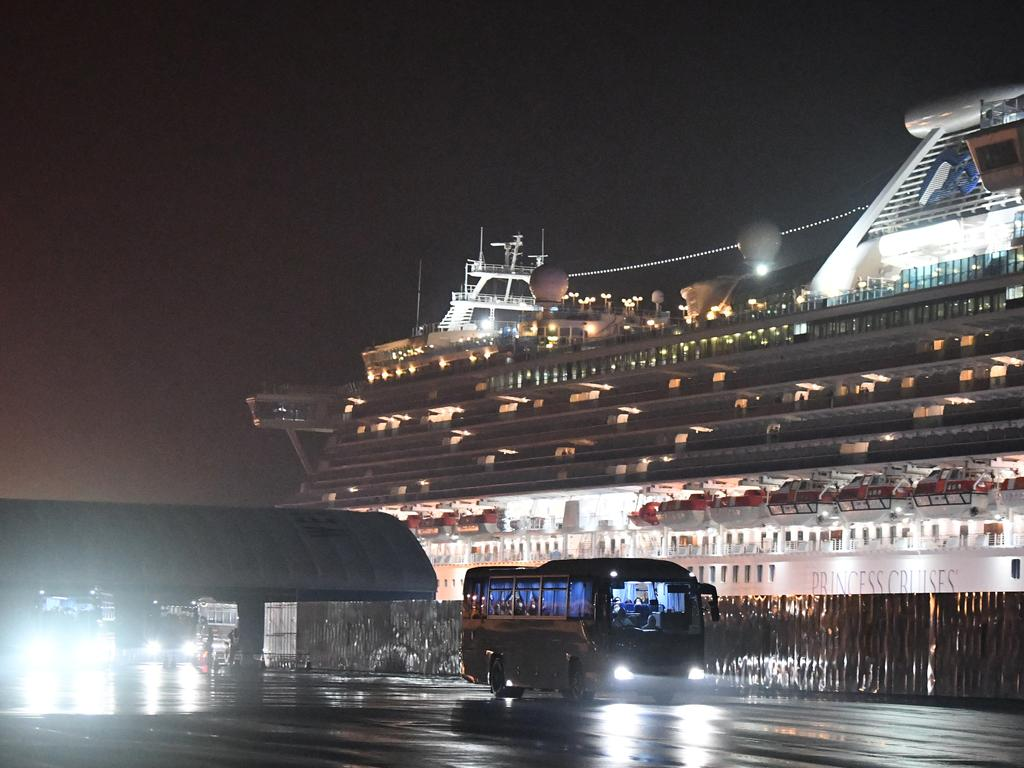 Buses carry American citizens from the quarantined Diamond Princess cruise ship. Picture: Getty