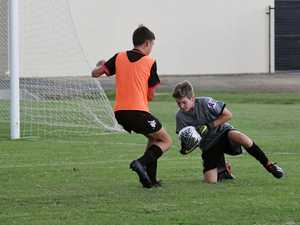 Magpie Crusaders goalie Matthew Vella dives on the