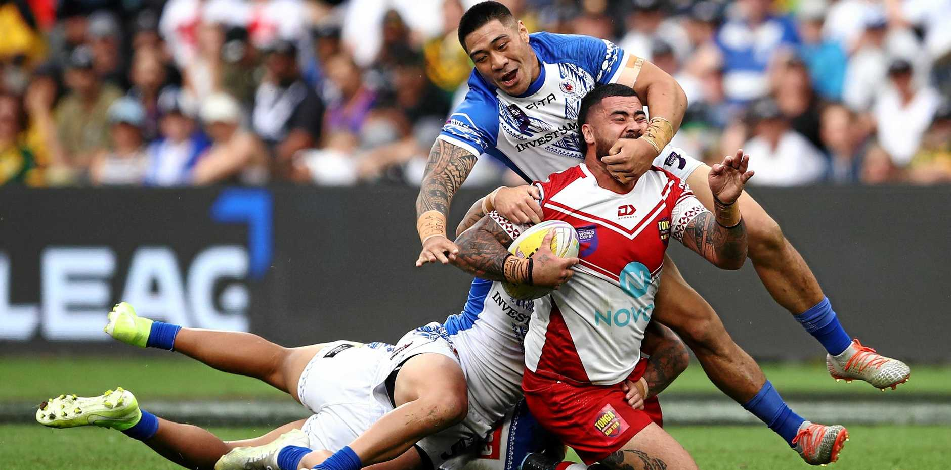 Andrew Fifita of Tonga is tackled by the Samoa defence in a men's pool game during the Downer Rugby League World Cup 9s in Sydney on October 19 last year. Picture: Brendon Thorne/AAP