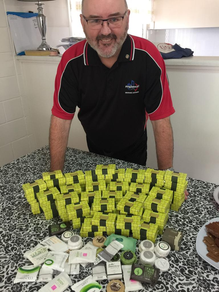 Neil Wallace with collection of little soaps he recently donated to the Days for Girls cause.