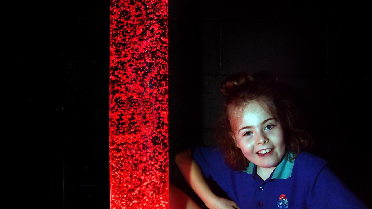 Nambour Special School student Bella Harris in the multi-sensory room which focuses on light sensory play. Photo: John McCutcheon