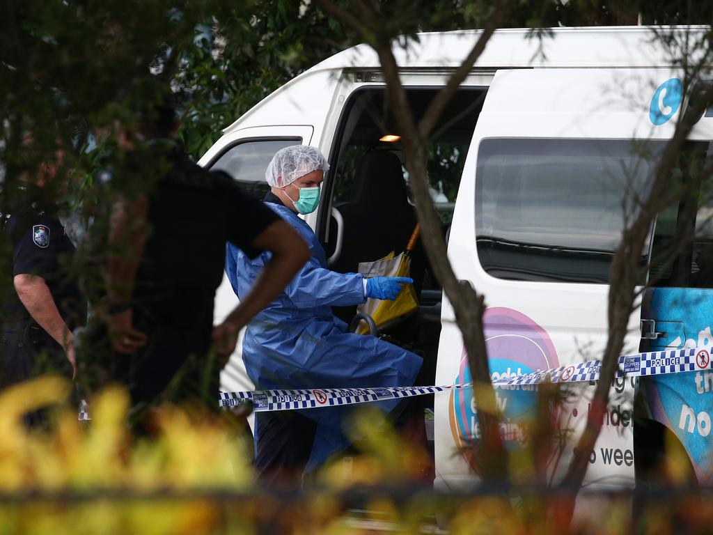A police forensic officer inspects the van at Hambledon State School in Edmonton. Picture: Brendan Radke