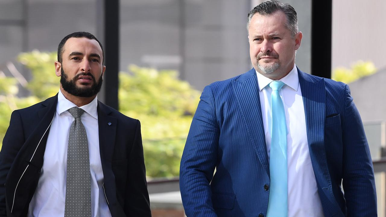 Adam Magill (right) and his lawyer Ahmed Dib arrive at the Brisbane Magistrates Court in Brisbane last year for a mention relating to four charges of breaching his bail. Picture: Dave Hunt