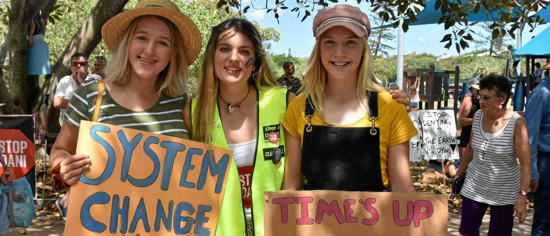 Peregian Beach's School Strike for Climate organiser Shellie Joseph with Lilly and Lotte Klein during the rally last March.