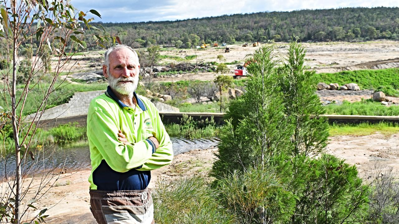 Alec Harslett overlooks the construction of a new dam at their Amiens property.