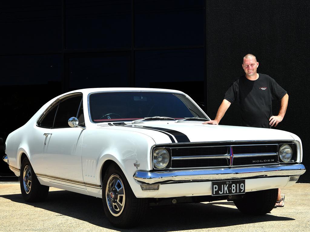 Warana's Shane Hudson with his 1969 Holden Monaro which he restored over 12 years. Photo: John McCutcheon