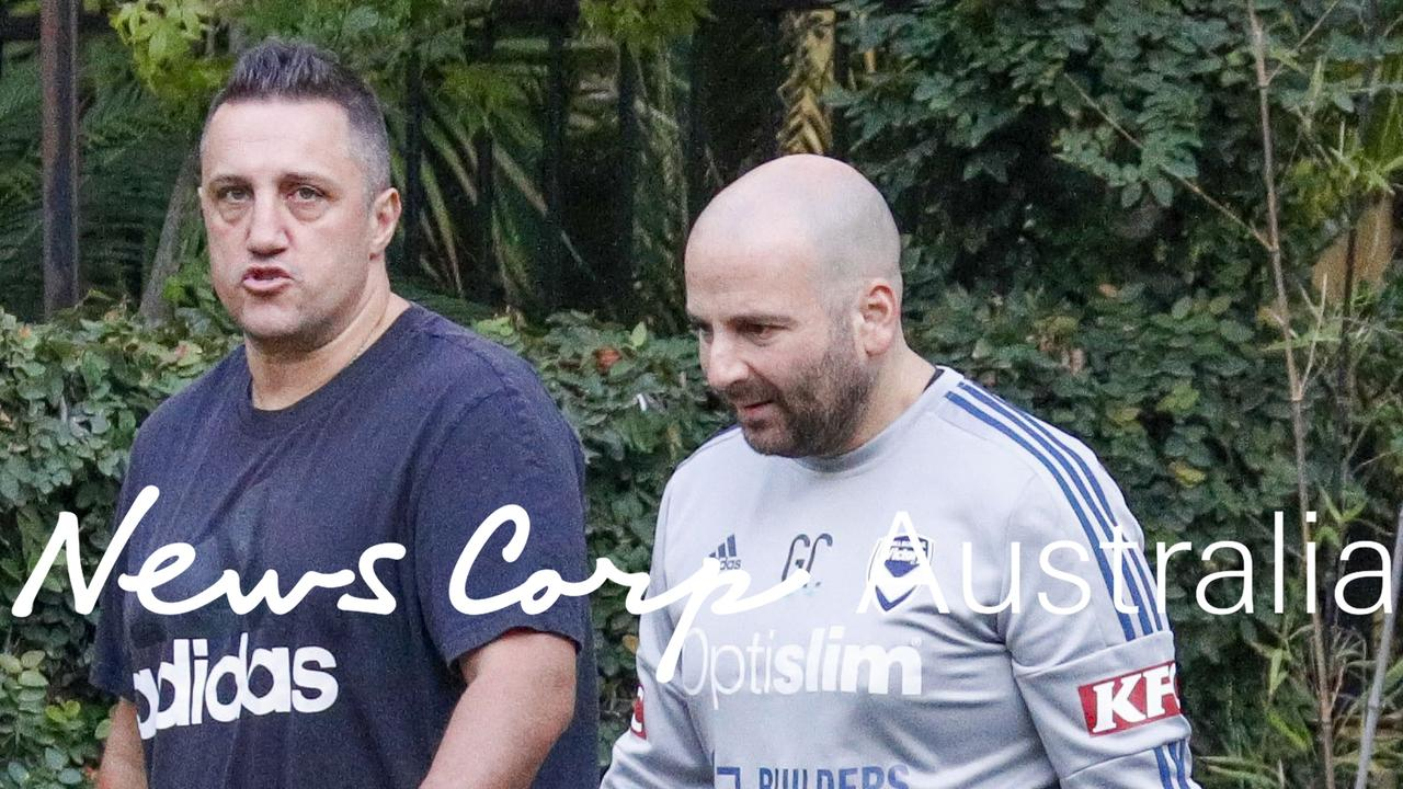 George Calombaris goes for a downcast walk with a friend in Melbourne yesterday as his restaurant empire collapsed even further. Picture: Media Mode