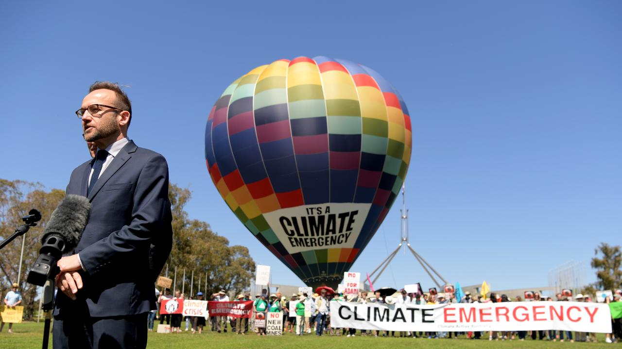 Greens MP Adam Bandt with a hot air balloon with 'Climate Emergency' on it, during a protest in front of Parliament House on October 15, 2019 in Canberra. (Photo by Tracey Nearmy/Getty Images)
