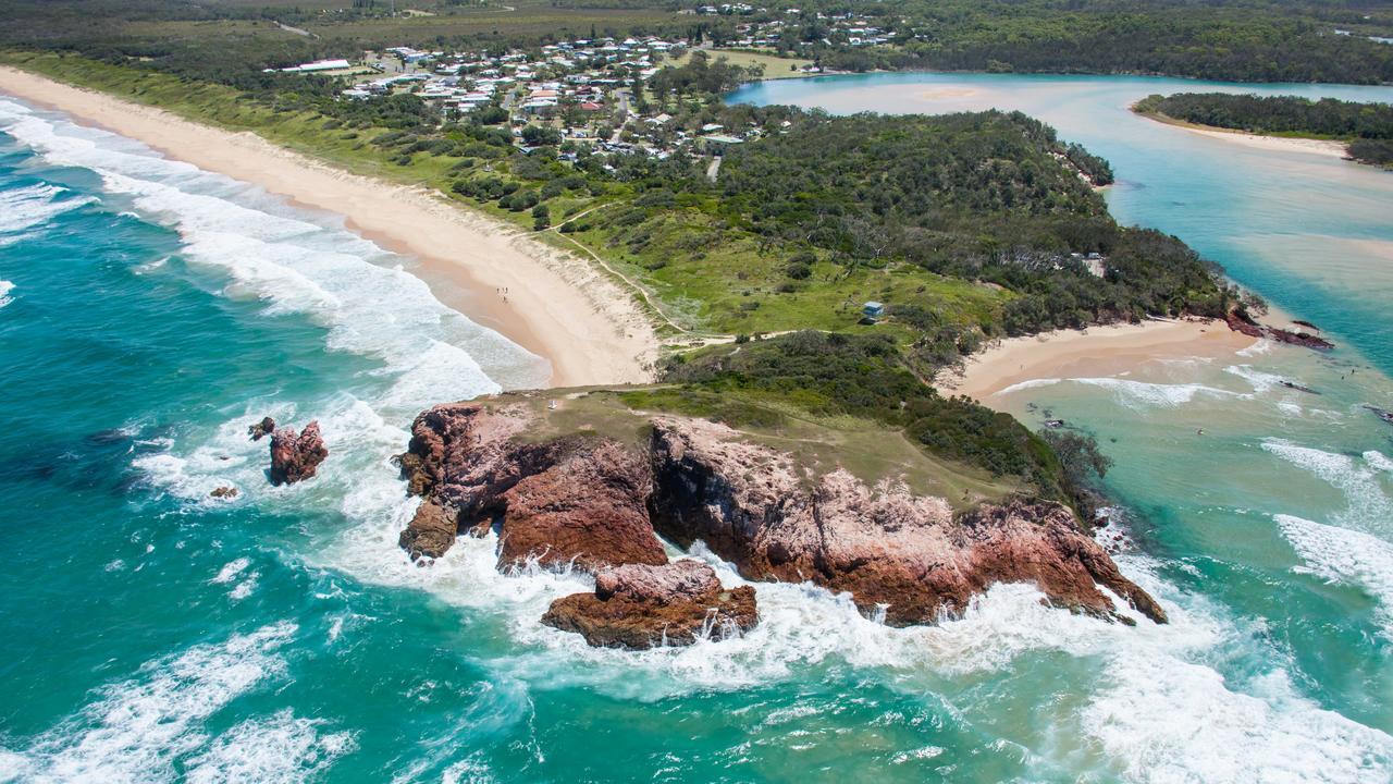 Red Rock Headland and the coastal holiday town of Red Rock. Photo: Destination NSW