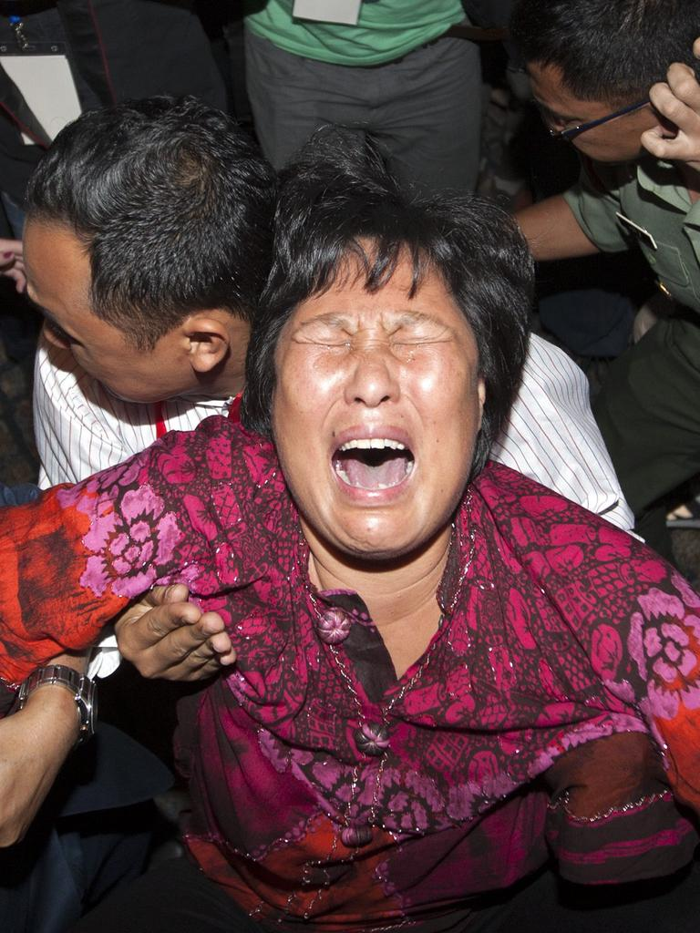 The loss of MH370 with 239 people on board left relatives around the world distraught. Picture: EPA