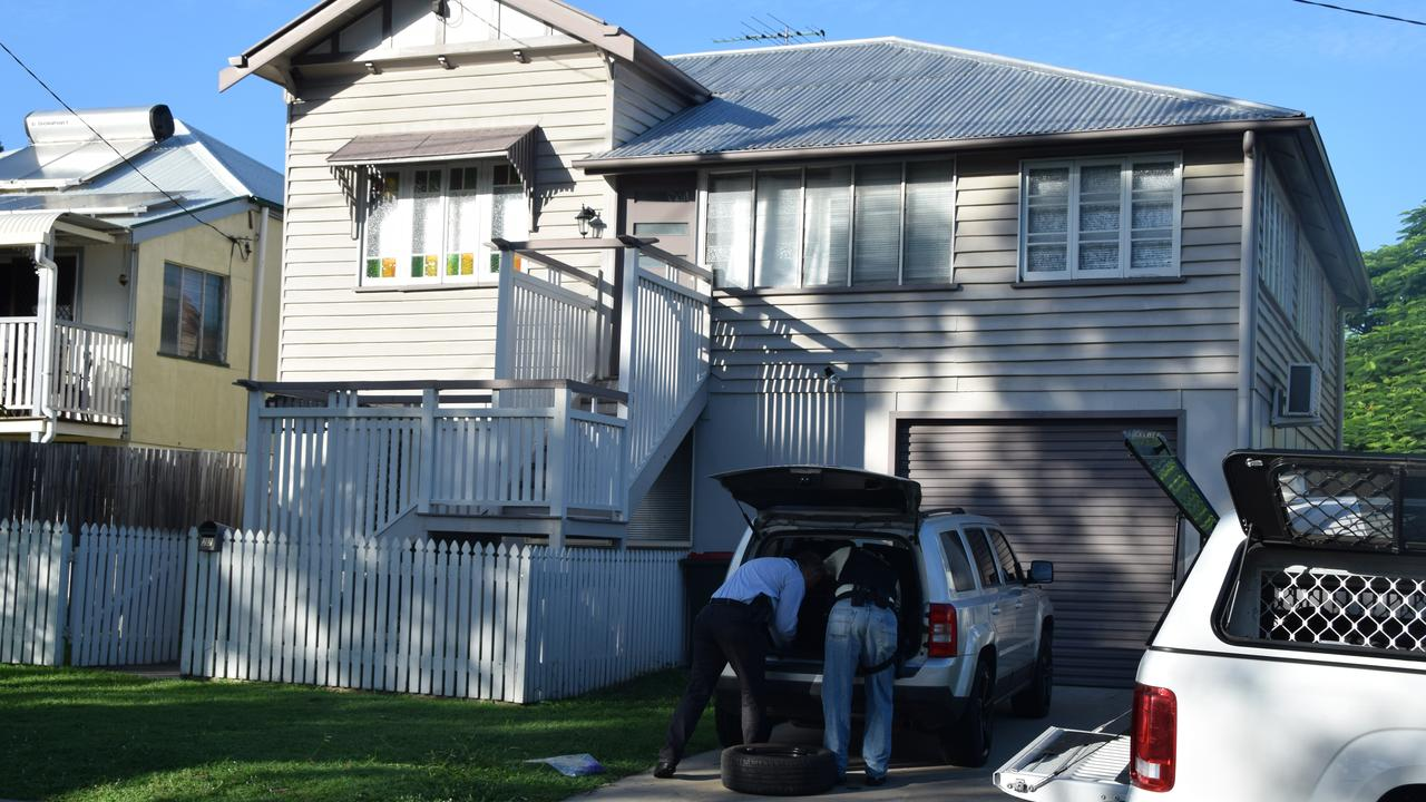 Police conducting searches at a home on Hardacre St in Wandal on February 19. The vehicles were later impounded.