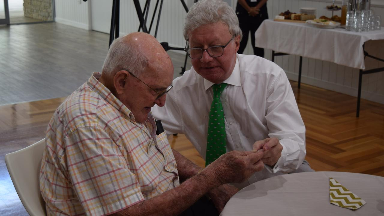 Queensland Governor General Paul de Jersey with centenarian Des Anderson at Carramar aged care.