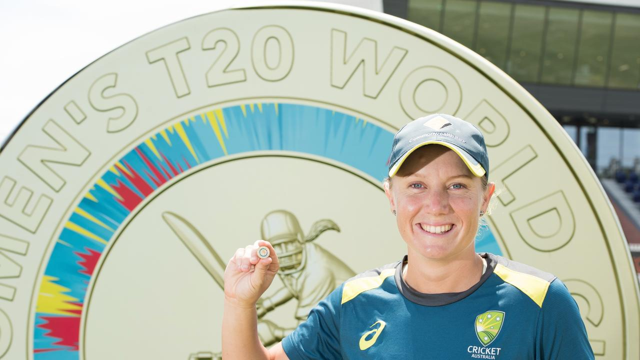 T20 Women's World Cup player Alyssa Healy with the new $2 coin with a female cricket player on its face. Picture: Supplied