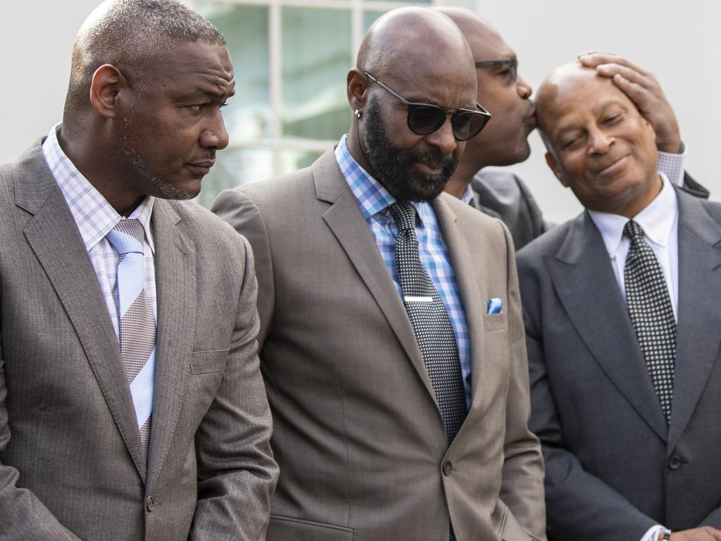 Former NFL football players Derrick Brooks, left, Jerry Rice, Charles Haley, and Ronnie Lott listen after walking out of the West Wing of White House. Picture: AP