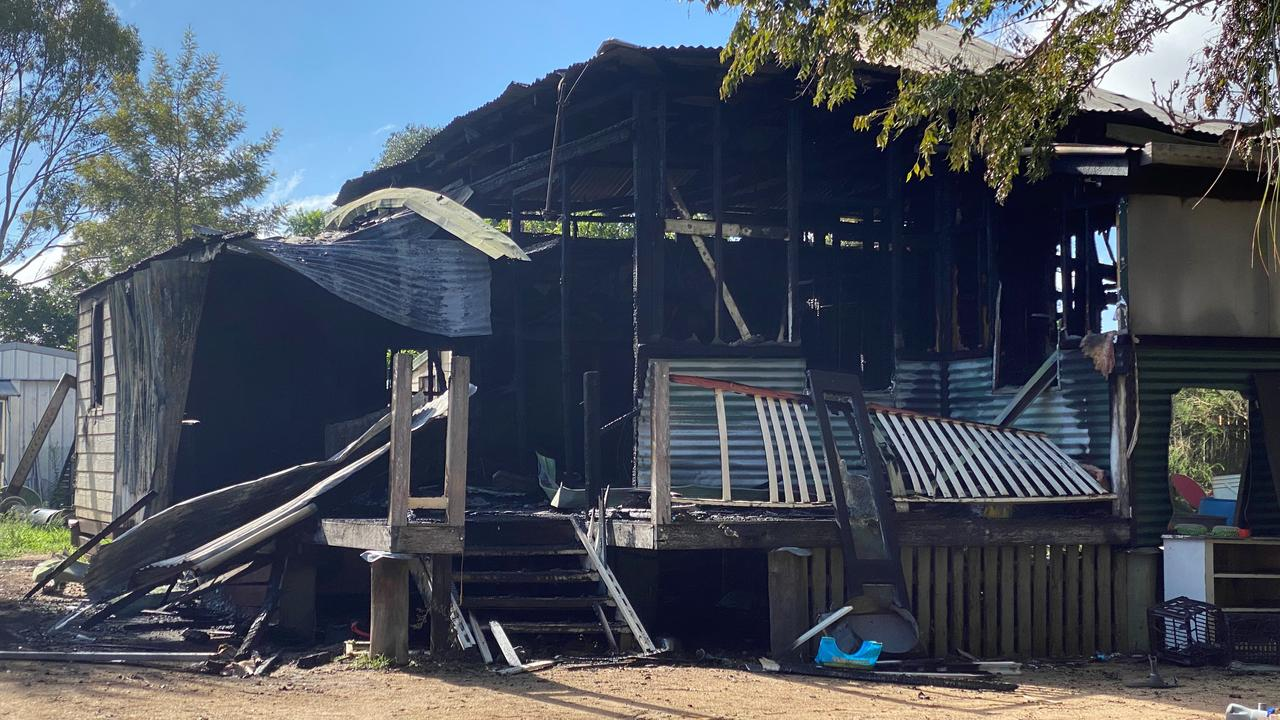 CHARRED REMAINS: What was left of a house on Burnett St in Kingaroy after a mysterious blaze decimated the majority of the property Monday morning.