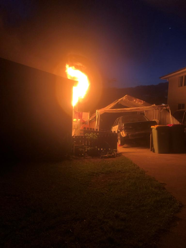 The fire bursts through the window at Stewart Terrace in Gympie on Tuesday night.