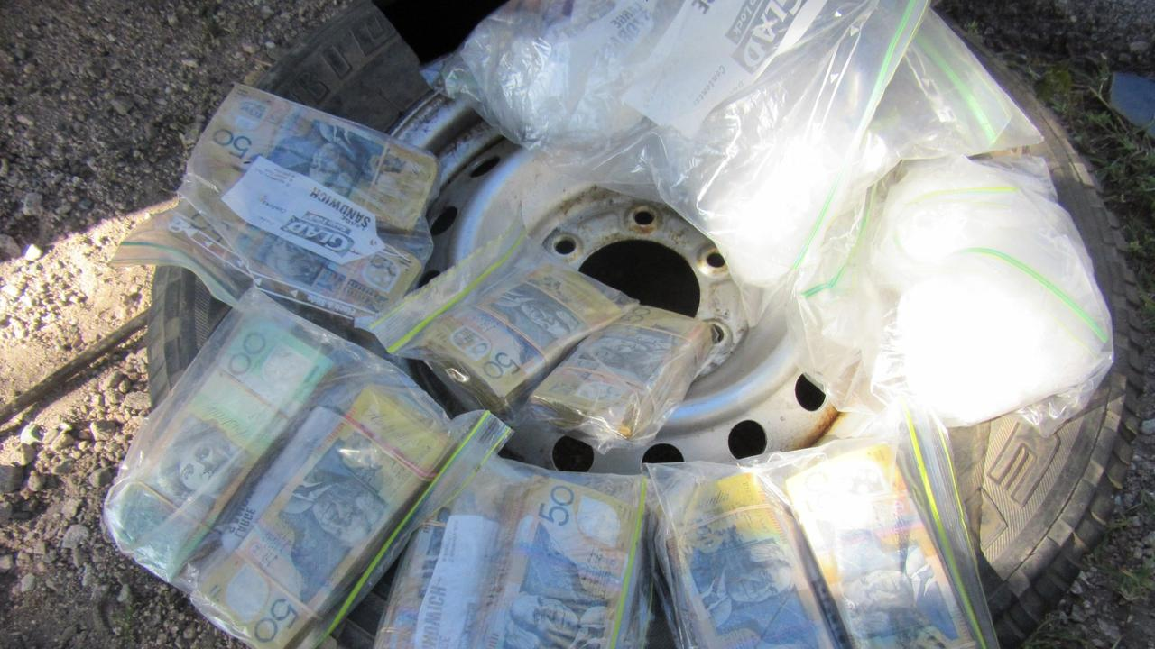 Detectives have seized drugs worth nearly $2 million and nearly $200,000 in cash after busting a pair of men allegedly stashing the illicit substances in the spare tyre of a car.