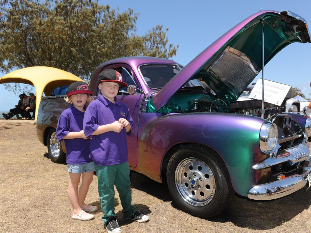 CAR SHOW: Zoey and Ethan next to an FJ Holden ute at the Bargara Beach Campout Car Show at Nielson Park Beach.Photo: Mike Knott / NewsMail