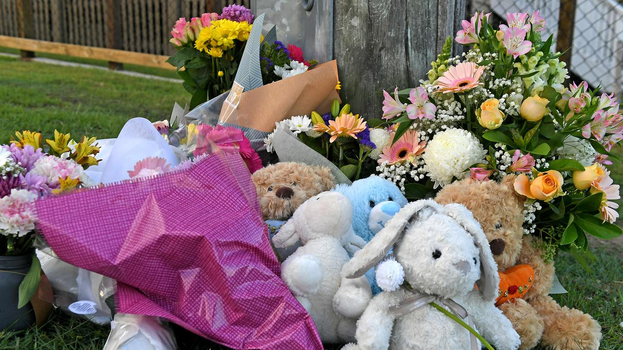 Flowers and cards left at the scene of the tragedy on Raven St, Camp Hill. Picture: AAP/John Gass
