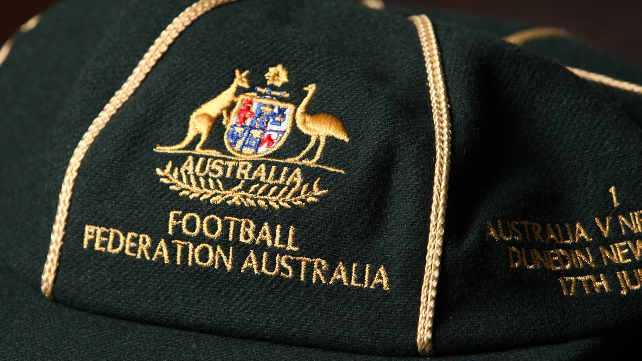 An Australian cap recognising Ipswich international footballers like Alex Gibb. Photo: Rob Williams
