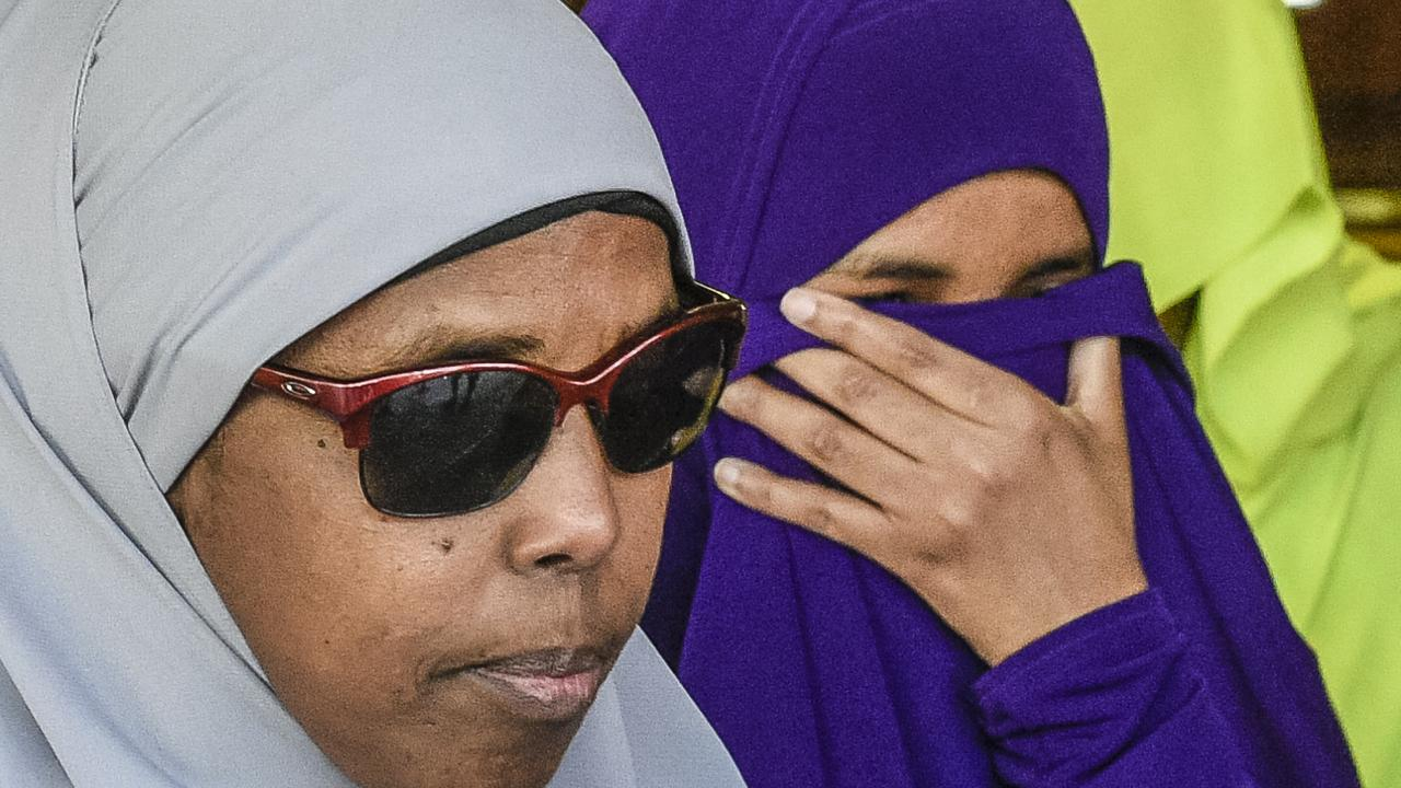 Ms Abdirahman Khalif, right, leaves court following her acquittal. Picture: AAP/Roy Vandervegt.