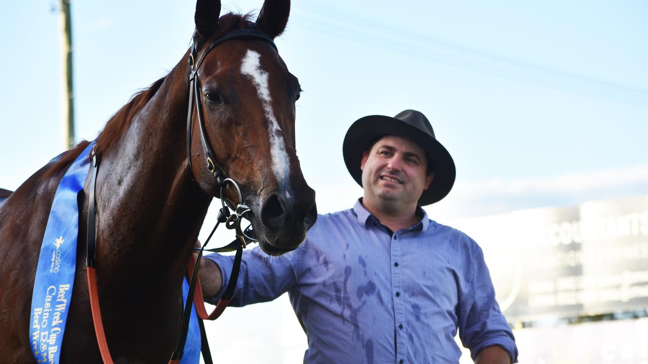 Queen of Kingston with trainer Daniel Bowen after it won the Beef Week Cup at Casino. The horse died after a race at Brisbane on the weekend. Photo Susanna Freymark