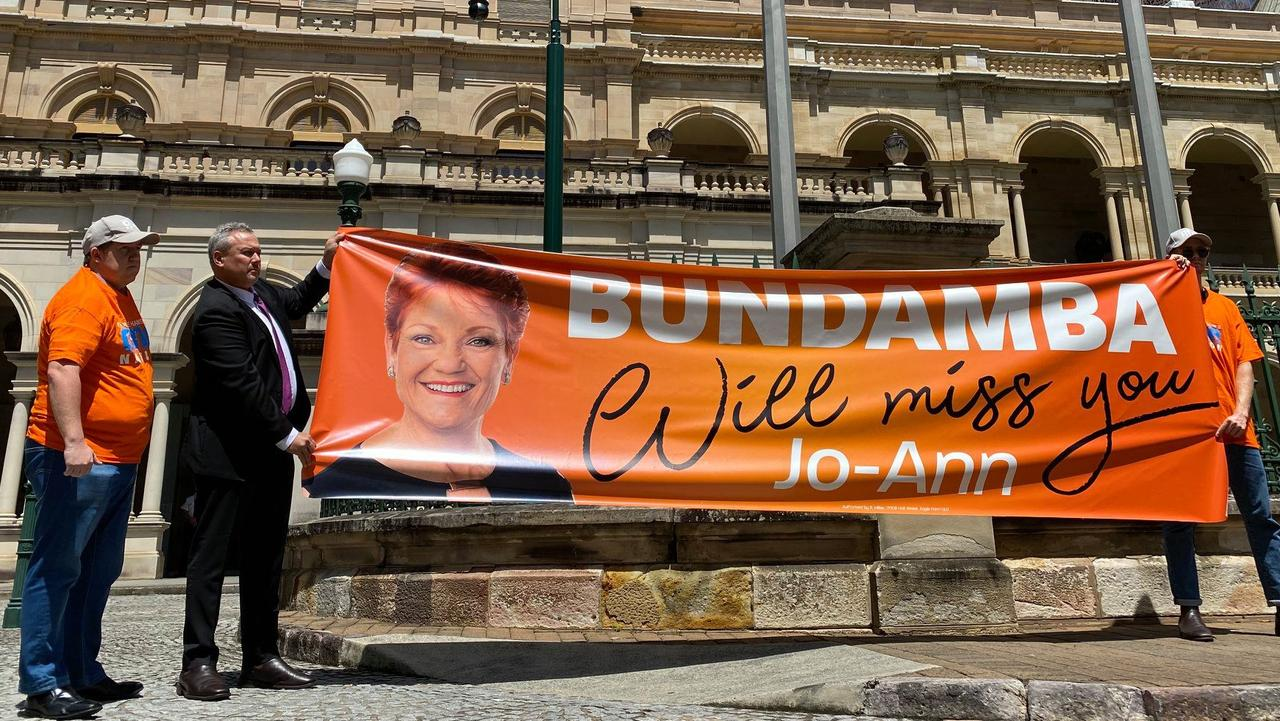 FAREWELL: Mirani MP Stephen Andrew and volunteers unveil a banner with a message for outgoing Bundamba MP Jo-Ann Miller.