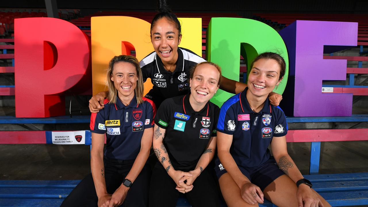 Darcy Vescio (back) with (L-R) Aliesha Newman, Tilly Lucas-Rodd and Ellie Blackburn as they celebrate the AFLW  Pride Round.