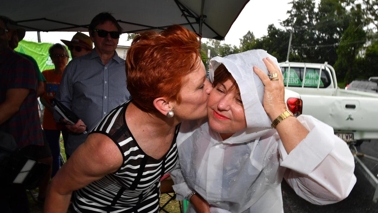 One Nation leader Senator Pauline Hanson (left) and ALP member for Bundamba, Jo-Ann Miller (right) are seen together in the suburb of Bundamba in Ipswich during the Queensland Election campaign on Tuesday, November 21, 2017. (AAP Image/Darren England)