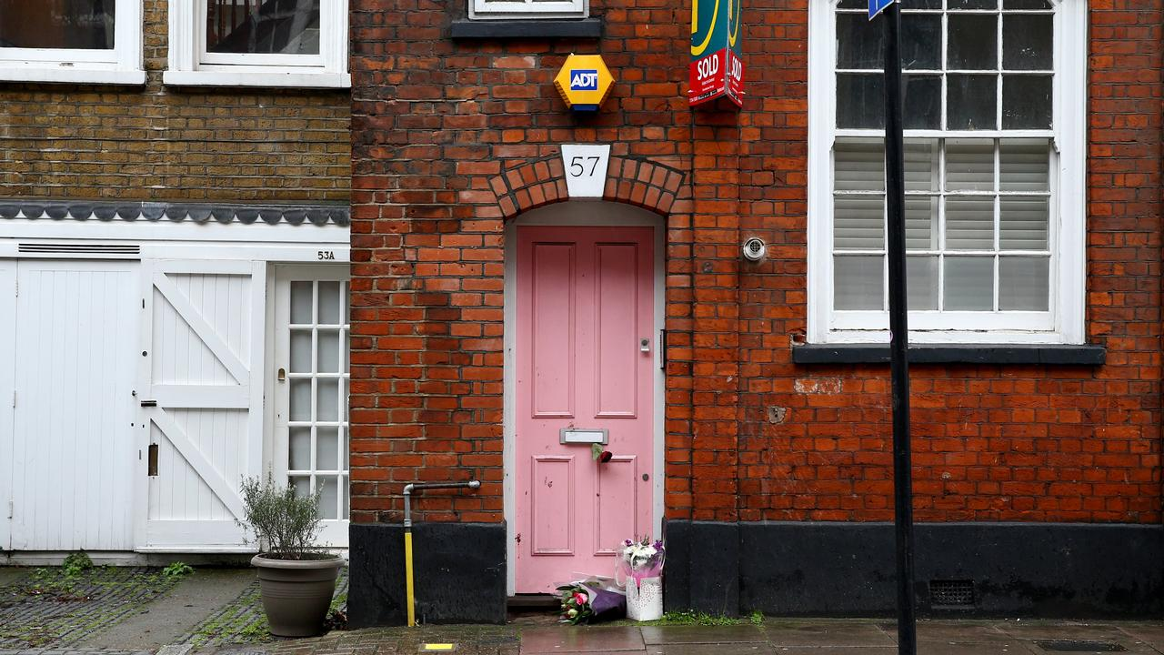 Flower tributes were laid outside her home in London this week. Picture: Hollie Adams/Getty Images