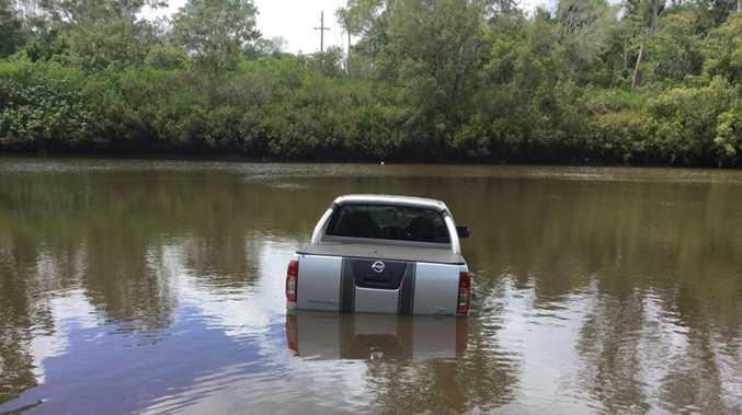 Stolen car dumped in river