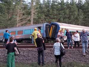 Search for missing after horror train crash kills two